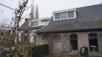 Verbouwing en plaatsen dakkapel woonboerderij te Kruisland